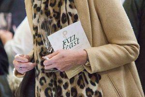 Lady Holding Fizz Feast Programme